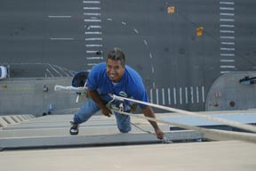 Controled Rope descent Window Cleaning Technician on Michigan commercial office building